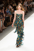 Strapless gown in a turquoise, black and gold print with a turquoise and beaded banded top.  By Carlos Miele at the Spring 2013 Mercedes-Benz Fashion Week in New York.