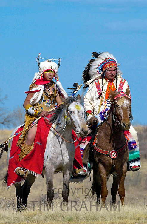 CANADIAN PLAINS INDIANS ON HORSEBACK WEARING TRADITIONAL COSTUMES AND FEATHER HEAD-DRESS AS PART OFTHE WELCOMING CEREMONY FOR PRINCE CHARLES DURING HIS VISIT TO WANUSKEWIN HERITAGE PARK, SASKATOON , CANADA.