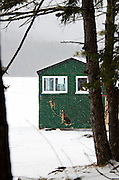 A green-painted ice fishing hut in Acadia National Park, Maine, was damaged when it fell through the ice a week earlier.