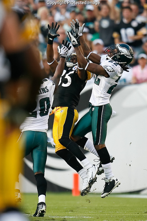 21 Sept 2008: Philadelphia Eagles defensive back Asante Samuel #22 and FS Brian Dawkins #20 come together on Pittsburgh Steelers wide receiver Nate Washington #85 for an interception during the game against the Pittsburgh Steelers on September 21st, 2008.  The Eagles won 15-6 at Lincoln Financial Field in Philadelphia Pennsylvania.