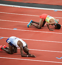 London, August 12 2017 . Mo Farah, Great Britain, and Muktar Edris, Ethiopia, kneel on the track after the men's 5000m final which saw Edris crowned world champion on day nine of the IAAF London 2017 world Championships at the London Stadium. © Paul Davey.