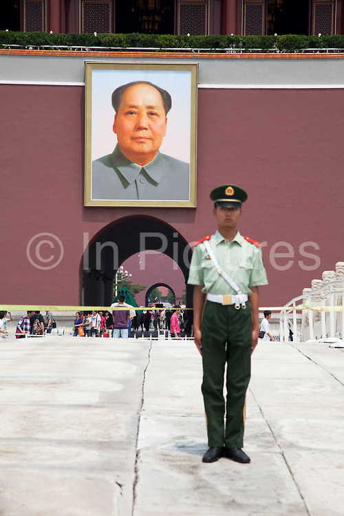 Security outside under ther portrait of Chairman Mao Zedong in Tiananmen Square at the Heavenly Gate of Peace, the entrance to The Forbidden City was the Chinese imperial palace from the Ming Dynasty to the end of the Qing Dynasty. It is located in the middle of Beijing, China, and now houses the Palace Museum. For almost 500 years, it served as the home of emperors and their households, as well as the ceremonial and political center of Chinese government. Built in 1406 to 1420, the complex consists of 980 buildings. The palace complex exemplifies traditional Chinese palatial architecture, and has influenced cultural and architectural developments in East Asia and elsewhere. The Forbidden City was declared a World Heritage Site in 1987, and is listed by UNESCO as the largest collection of preserved ancient wooden structures in the world.