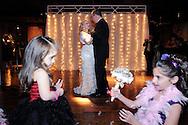 Steve and Elaine Mona during their wedding reception at the Metropolitan Building in Long Island City, NY on Saturday, November 16, 2013.  © Chet Gordon • Photographer