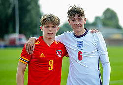 NEWPORT, WALES - Friday, September 3, 2021: Liverpool duo Iwan Roberts (L) of Wales and England's Luke Chambers pose for a picture after an International Friendly Challenge match between Wales Under-18's and England Under-18's at Spytty Park. The game ended in a 1-1 draw. (Pic by David Rawcliffe/Propaganda)