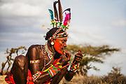 A portrait of a Samburu warrior applying facial pain,,Samburu, Kenya, Africa