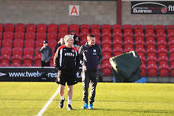 Leicester City's Jamie Vardy (right) joins Fleetwood staff on the pitch
