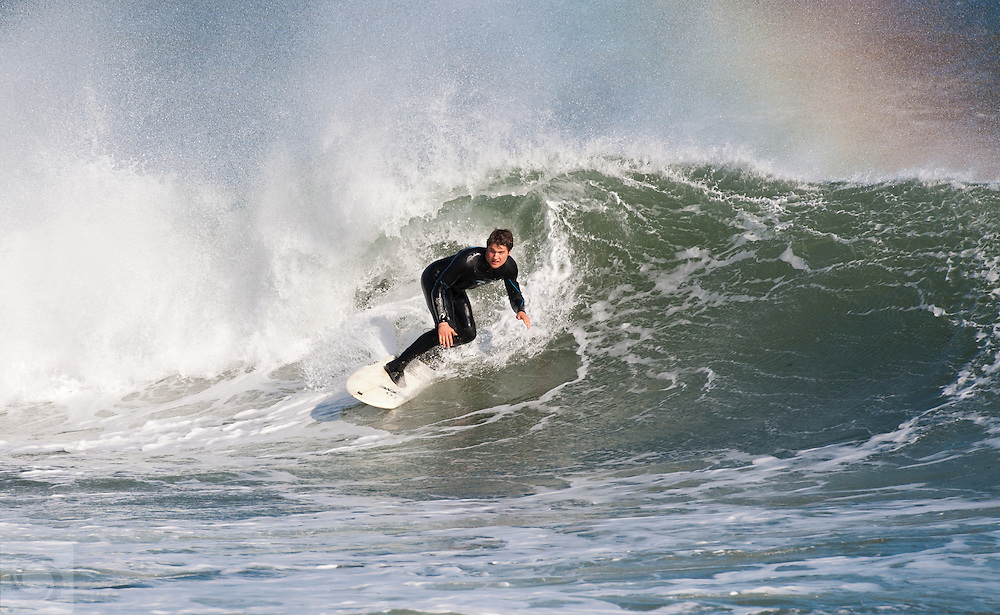 Surfing during big autumn swell in 2011 at Monahan's Dock in Narragansett, Rhode Island.  Big waves, warm sun, sea spray and rainbows make for an epic wave.