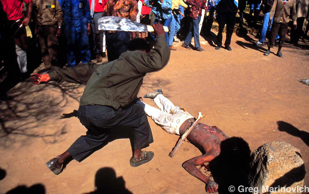 SAFRICA:An  ANC supporter hacks  at an  alleged IFP supporter who was blamed for taking part in the Boipatong massacre of 1992.(Photo by Joao Silva/PictureNET)