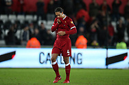 Virgil van Dijk of Liverpool is dejected at the end of the game. Premier league match, Swansea city v Liverpool at the Liberty Stadium in Swansea, South Wales on Monday 22nd January 2018. <br /> pic by  Andrew Orchard, Andrew Orchard sports photography.