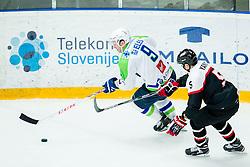 Tomaz Razingar of Slovenia vs Kotaro Yamada of Japan during ice-hockey friendly match between National teams of Slovenia and Japan, on April 10, 2015 in Arena Podmezakla, Jesenice, Slovenia. Photo by Vid Ponikvar / Sportida