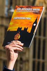 Westminster, London, October 14th 2015. Members of the FBU gather outside Parliament as they prepare to lobby MPs over cuts, the Trade Union Bill and the possibility of their service falling under the control of Police and Crime Commissioners.