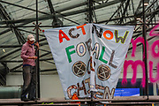 A member of Extinction Rebellion who shouted 'I LOVE MY CHILDREN' is seen spraying '4 Degree is Mass Murder' in the windows of Department for Business and Energy in Victoria Street, central London on Monday, Sept 7, 2020. The activist also unfurled a banner saying 'ACT NOW FOR ALL OUR CHILDREN' - and glued his hands into the iron bars of the building.<br /> Environmental nonviolent activists group Extinction Rebellion enters its 7th day of continuous ten days protests to disrupt political institutions throughout peaceful actions swarming central London into a standoff, demanding that central government obeys and delivers Climate Emergency bill. (VXP Photo/ Vudi Xhymshiti)