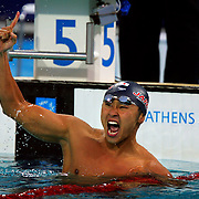 Kosuke Kitajima of Japan celebrated after seeing his gold medal winning time in the 100 meter breaststroke final at the Olympic Aquatic Centre in the Summer Olympics in Athens, Greece.