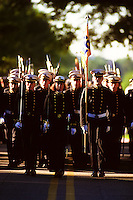 "Annapolis, Maryland--Midshipmen at the United States Naval Academy march durring a Color Parade.The Color Parade is the oldest special parade at the U.S. Naval Academy, a tradition that began in 1871. In its last full dress parade, the company that has excelled academically, athletically and professionally throughout the year is honored by receiving the ""colors"" (company flags) of last year's winners."