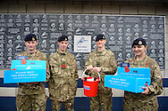Soldiers with Poppy Boxes and Buckets collect outside The Den Stadium before k/o. Skybet football league championship match , Millwall v Cardiff city at the Den in Millwall, London on Saturday 25th October 2014.<br /> pic by John Patrick Fletcher, Andrew Orchard sports photography.