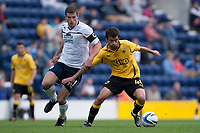Football - Pre Season Friendly - Preston vs. AEK Athens<br /> John Mousinho of Preston North End and Dimitrios Grontis of AEK Athens battle at Deepdale