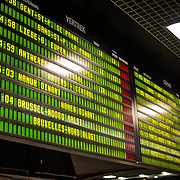 A digital schedule board displaying departures and arrivals at Gare Centrale in downtown Brussels, Belgium.