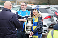 Wimbledon fans holding the FA Cup before the EFL Sky Bet League 1 match between AFC Wimbledon and Plymouth Argyle at the Cherry Red Records Stadium, Kingston, England on 26 December 2018.