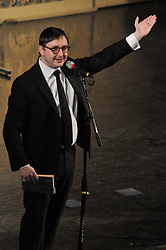 Jon Hodgman, pronouncing for, or possibly gesturing to Jonathan Coulton, at Century on a Spree: The Whiffenpoof Centennial (1909-2009)