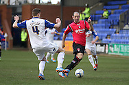Oldham Athlteic's Gary Harkins ® looks to go past Tranmere Rovers' Ash Taylor. Skybet football league 1match, Tranmere Rovers v Oldham Athletic at Prenton Park in Birkenhead, England on Saturday 1st March 2014.<br /> pic by Chris Stading, Andrew Orchard sports photography.