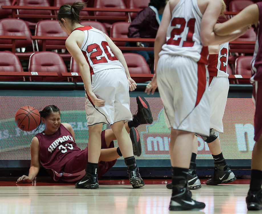Shiprock's Ashley John chases a loose ball out of bounds as Portales defender Hannah Cissell watches during the second half. Shiprock defeated Portales 35-33 in the AAA semifinals Thursday morning in Albuquerque at The Pit.