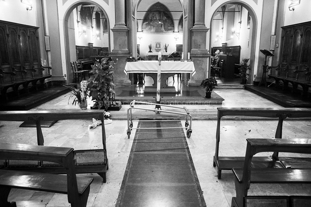PISTOIA, ITALY - 17 DECEMBER 2015: The casket carrier of Licio Gelli's casket is here in the Misericordia church shortly after the funeral, in Pistoia, Italy, on December 17th 2015.