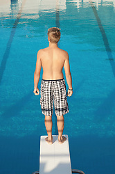 Swimming pool boy diving board fun holiday