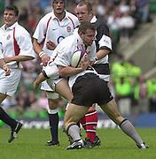 Twickenham. England. RFU Stadium, Surrey. <br /> Photo Peter Spurrier25/05/2003<br /> 2003 - Rugby - England v Barbarians.<br /> Mark Regan is tackled by Mark Robinson         [Mandatory Credit: Peter SPURRIER/Intersport Images]