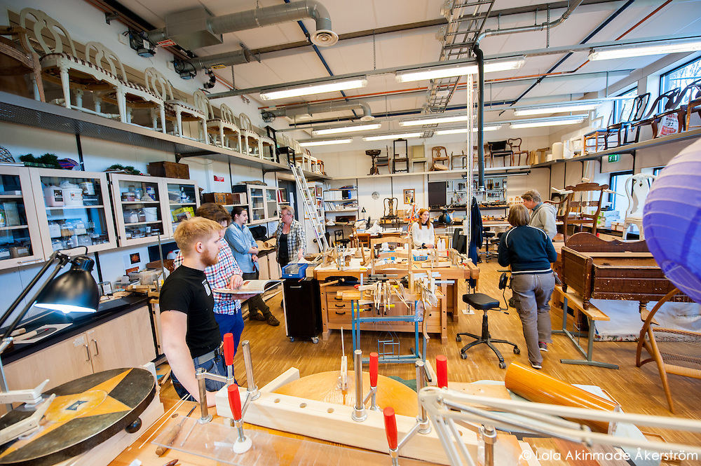 Students and instructors collaborating in the cabinetmaking department of the school.