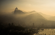 The Cristo Redemtor statue over Rio de Janeiro as low cloud moves in from the sea. Scenes from Rio de Janeiro on the day that Brazil drew 0-0 with Mexico. Photo by Andrew Tobin/Tobinators Ltd