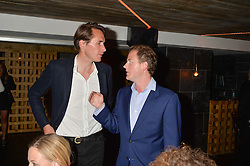Left to right, OTIS FERRY and GUY PELLY at the launch of Geisha at Ramusake hosted by Piers Adam and Marc Burton at Ramusake, 92B Old Brompton Road, London on 11th June 2015.
