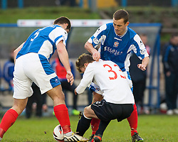 Falkirk's Rory Loy between Cowdenbeath's John Armstrong and Cowdenbeath's Aaron Lynas.<br /> half time : Cowdenbeath 0 v 0 Falkirk, Scottish Championship game today at Central Park, the home ground of Cowdenbeath Football Club.<br /> © Michael Schofield.