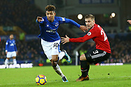 Mason Holgate of Everton (l) gets away from Luke Shaw of Manchester United. Premier league match, Everton v Manchester Utd at Goodison Park in Liverpool, Merseyside on New Years Day, Monday 1st January 2018.<br /> pic by Chris Stading, Andrew Orchard sports photography.