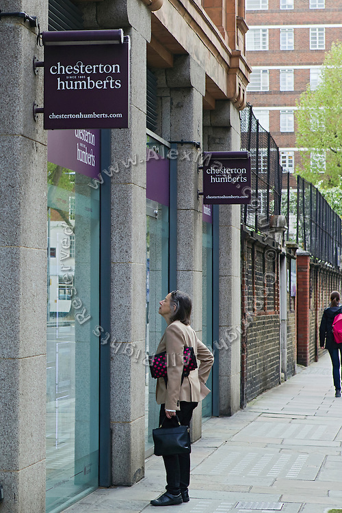 A woman is looking at luxury homes on sale in the office of Chesterton Humberts, 60 Sloane Ave, Chelsea, London, United Kingdom.<br /> <br /> CREDIT: Alex Masi for The Wall Street Journal<br /> CHESTERTON<br /> <br /> The name of London real-estate agency Chesterton Humberts exudes English affluence. But in early 2011, as Libya was engulfed in revolution, a substantial stake in the firm was quietly acquired by the wealthy family of a longtime lieutenant to Moammar Gadhafi, according to a person with direct knowledge of the investment.