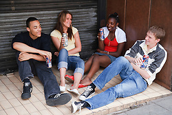 Group of teenagers drinking.