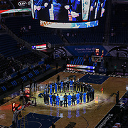 ORLANDO, FL - APRIL 12: Orlando Magic and San Antonio Spurs players and coaches lock arms in a tribute to Minnesota shooting victim Daunte Wright prior to their game at Amway Center on April 12, 2021 in Orlando, Florida. NOTE TO USER: User expressly acknowledges and agrees that, by downloading and or using this photograph, User is consenting to the terms and conditions of the Getty Images License Agreement. (Photo by Alex Menendez/Getty Images)*** Local Caption *** Daunte Wright
