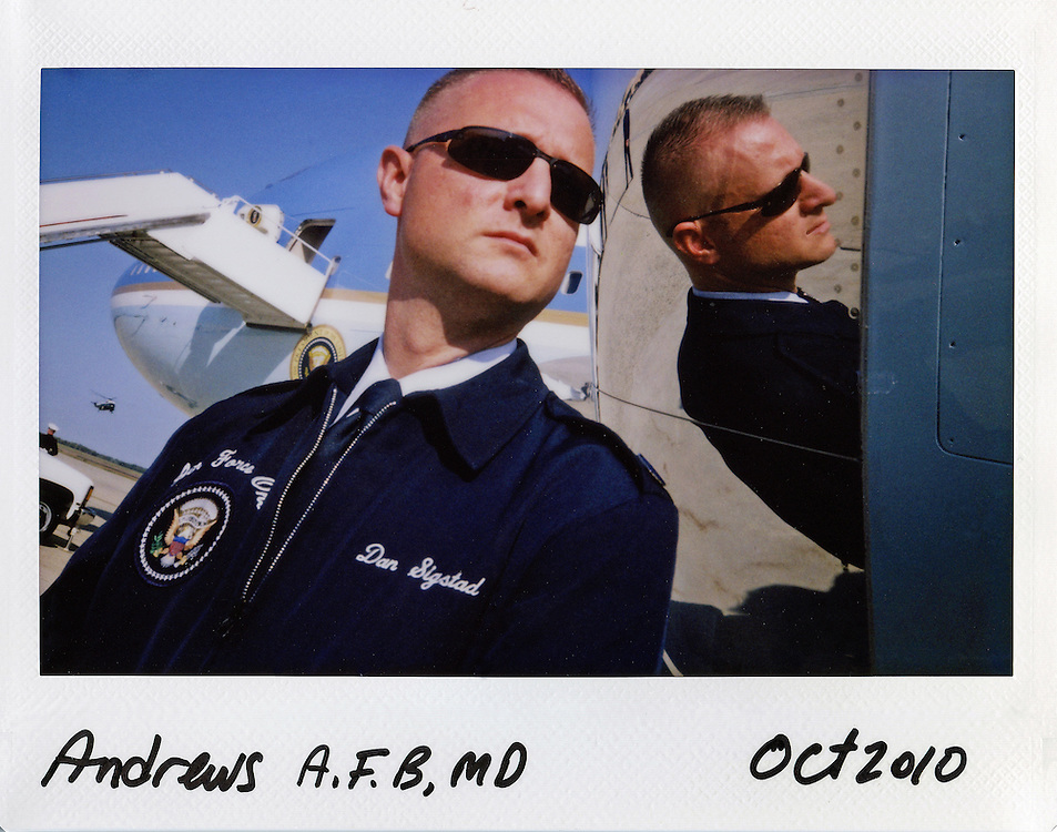 Air Force personnel stands beside Air Force One as U.S. President Barack Obama arrives on Marine One at Andrews Air Force Base near Washington, October 10, 2010.