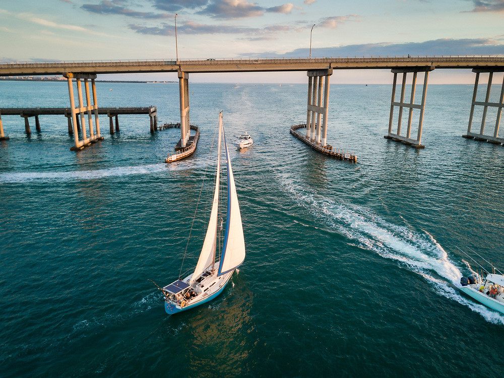MIAMI, FLORIDA - CIRCA APRIL 2017: Aerial view of motor and sail  boats over Biscayne Bay with view of the Rickenbacker Causeway in Key Biscayne.
