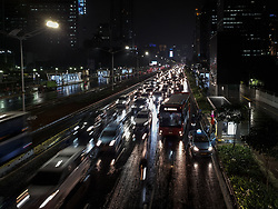 March 26, 2019 - South Jakarta, Jakarta, Indonesia - Jakarta, Indonesia, 26 March 2019 : Night of Jakarta at South Jakarta in Business District Area still with traffic but also with beautiful bridge that attract people to take selfie. Jakarta Government Making Sudirman Street of Jakarta look more beautiful and modern, to support people more enjoying using MRT day and night. Although MRT already operated and claimed can reduce traffic at Jakarta but the reality far from what it meant to be. (Credit Image: © Donal HusniZUMA Wire)