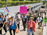 """08 APRIL 2014 - BANGKOK, THAILAND: Anti-government protestors march into the Ministry of Justice compound in Bangkok. Several hundred anti-government protestors led by Suthep Thaugsuban went to the Ministry of Justice in Bangkok Tuesday. Suthep and the protestors met with representatives of the Ministry of Justice and expressed their belief that Thai politics need to be reformed and that corruption needed to be """"seriously tackled."""" The protestors returned to their main protest site in Lumpini Park in central Bangkok after the meeting.    PHOTO BY JACK KURTZ"""