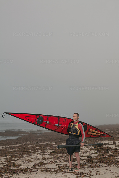Portrait of Duane Strosaker with his sea kayak and Greenland paddle. Photo © Robert Zaleski / rzcreative.com<br /> —<br /> To license this image contact: robert@rzcreative.com