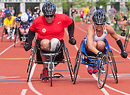 West Point, New York - Army's Kelly Elmlinger, right, edges Army's Dan Hendrix at the finish line of their heat of the wheelchair 100-meter dash at the United States Military Academy Preparatory School on Tuesday, June 17, 2014.<br /> Hosted by the U.S. Army Warrior Transition Command (WTC), the trials determine which athletes will compete at the 2014 Warrior Games this fall in Colorado Springs, Colorado.