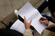 A student studies maths outside at London Metropolitan University's Holloway Road campus.