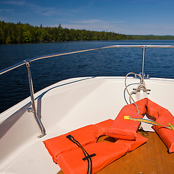 Lifejackets in the bow of a small boat on Branch Lake in Ellsworth, Maine.