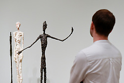 """© Licensed to London News Pictures. 08/05/2017. London, UK. A staff member view """"Man Pointing"""", 1947.  Preview of the UK's first major retrospective of Alberto Giacometti for 20 years at Tate Modern.  The exhibition runs 10 May to 10 September 2017. Photo credit : Stephen Chung/LNP"""