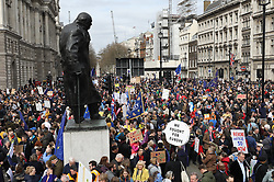 © Licensed to London News Pictures. 23/03/2019. London, UK. Thousands of demonstrators gather in Parliament Square as they take part in the 'Put It To The People march' through central London. The People's Vote Campaign are calling for a second referendum on the United Kingdom's membership of the European Union. Photo credit: Peter Macdiarmid/LNP