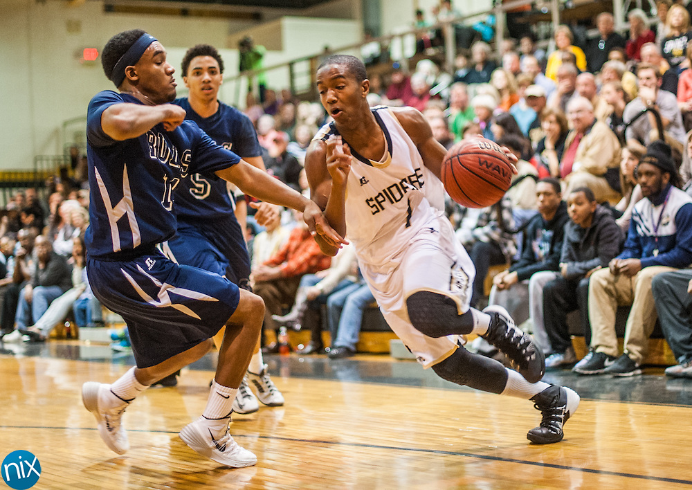 Concord's Ty-Shon Alexander drives to the basket against Hickory Ridge's Avery Metcalf Friday night at Concord High School. Concord won the game 88-76.