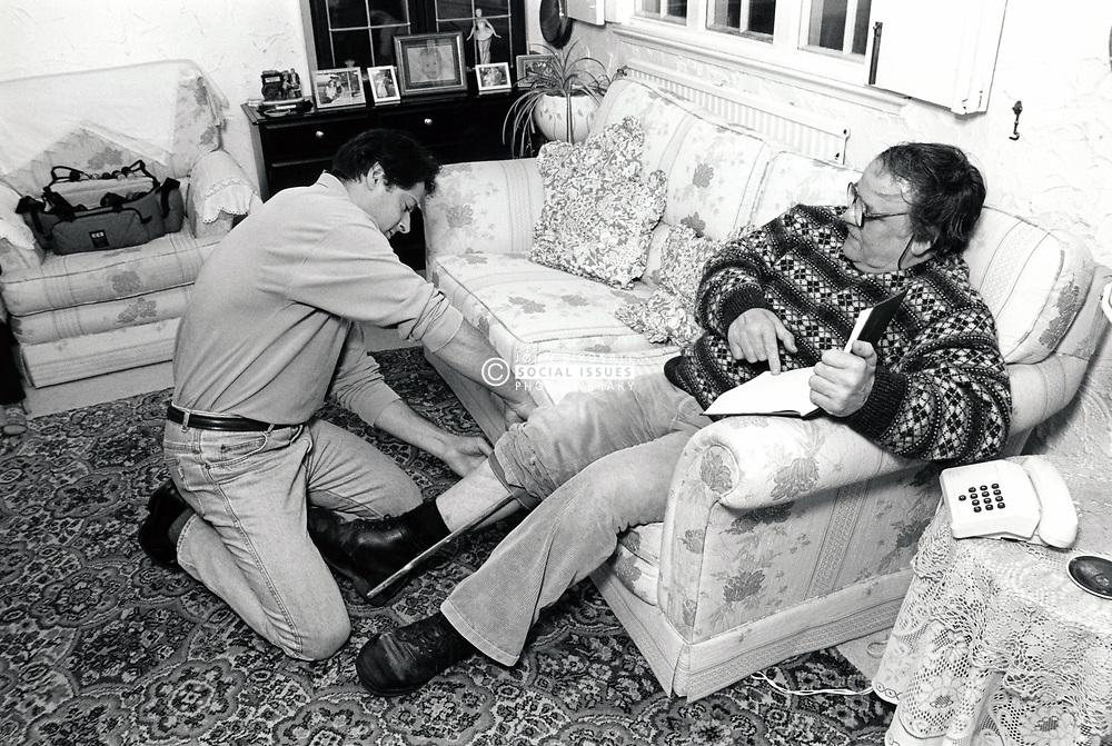 Carer & elderly man UK 1991