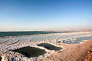 Israel, Evaporation pools on the shores of the Dead Sea. The pools are maintained by the Dead Sea Works to mine the salt and potassium from the water
