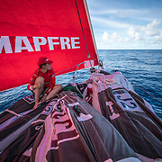 Leg 4, Melbourne to Hong Kong, day 07 on board MAPFRE, Tamara Echegoyen on the sitting on the sails looking at Dongfeng in the horizon. Photo by Ugo Fonolla/Volvo Ocean Race. 08 January, 2018.